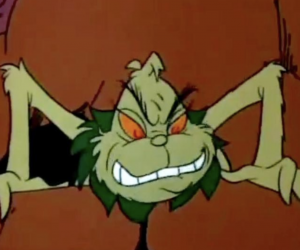 Grinch crouched on Rocks